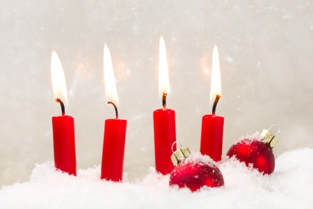 x mas: Four red candle with christmas ball