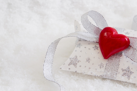 Close up of white and silver present box with red hearts photo