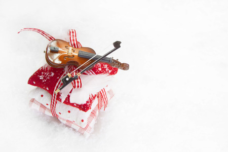 x mas: Three bean bag with ribbon and violin Stock Photo