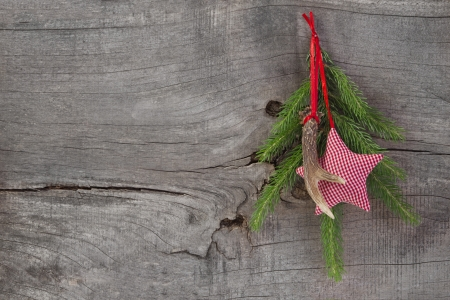 Top view of christmas decoration with antler and checked star photo