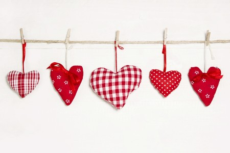 sewn up: Close up of hanging different pattern hearts
