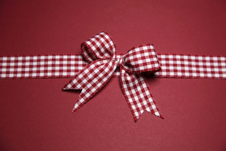 Claret greeting card with checked ribbon photo