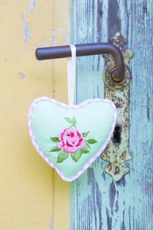Heart shape hanging on door handle