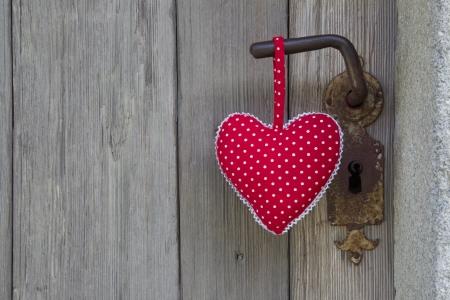 Polka dotted heart shape hanging on door handle