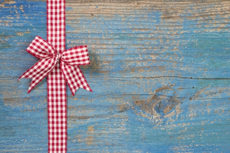 git: Top view of checked ribbon decoration on turquoise wooden background Stock Photo