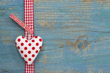 Handmade heart shape against blue wooden surface  Stock Photo