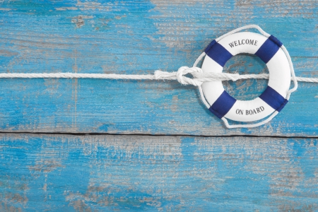 rigging: Blue wooden background with  welcome on board  for maritme decoration or teamwor