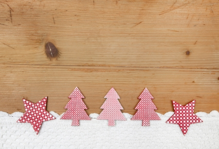 Red christmas trees on a wooden background photo