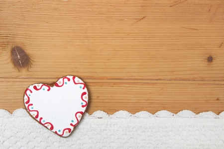 Heart on a wooden background for christmas photo