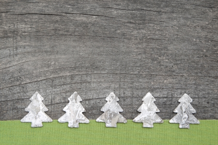 e card: Wooden grey and green christmas background with a christmas tree Stock Photo