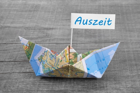 auszeit: Paper boat folded out of a map - time to relax