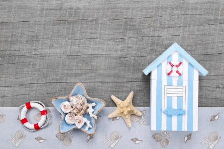 beach hut: Beach hut and seashells on a wooden background for a greeting card Stock Photo