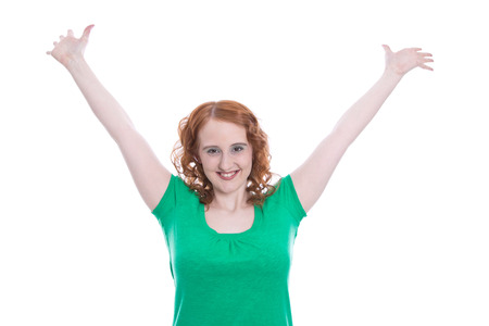 succesful woman: Studio shot of redhead succesful caucasian woman standing with raised arms