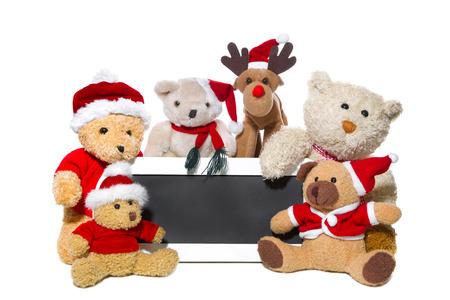 osos navideños: Trabajo en equipo - grupo de osos de peluche dice Feliz Navidad con una tabla de madera negro
