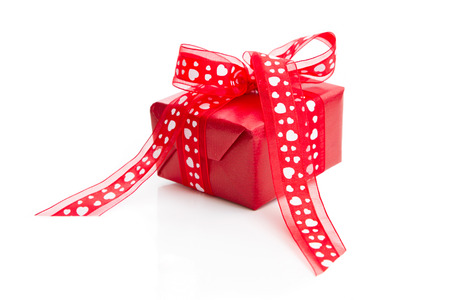 Red isolated giftbox for valentine, wedding, birthday, mother s day or christmas photo