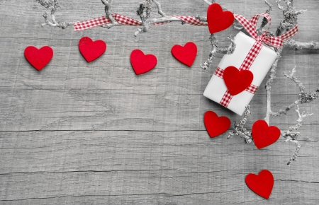 valentine's: Gift or present with red hearts for mother s day, valentine s day, christmas or birthday on a wooden background for a greeting card