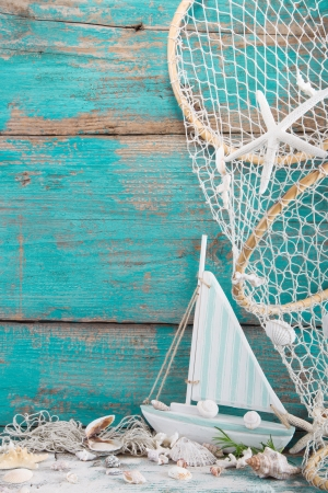 yachting: Turquoise wooden background with a sailing baoat for a holiday concept Stock Photo