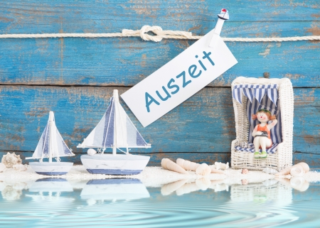 German greeting card with text - Auszeit - decoration blue and maritim - ocean photo