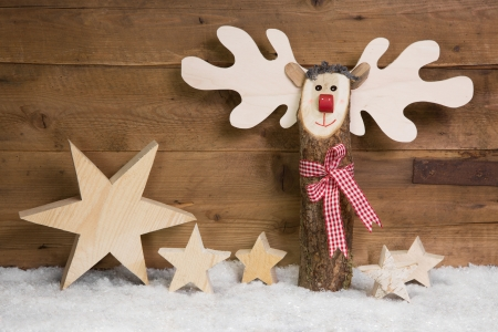 Wooden background with a reindeer or elk for a christmas greeting card photo