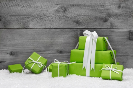 copy: Christmas greeting card or voucher with green gift boxes