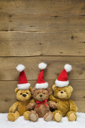 Teamwork  wooden background for Christmas with teddy bears photo