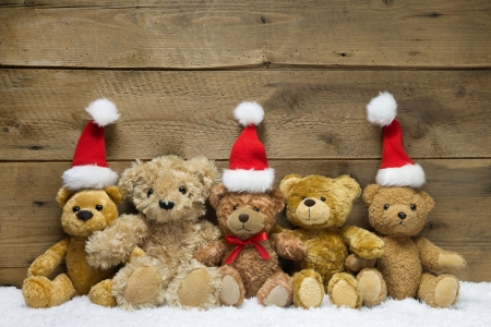 A team from teddy bears for christmas on a wooden background  photo