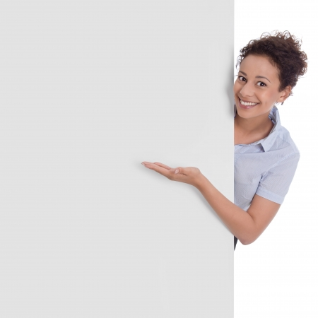 Isolated smiling business woman pointing at presentation signboard