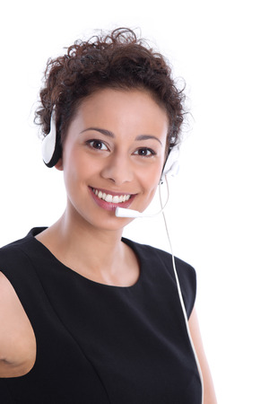 facing the camera: Isolated pretty business woman smiling with headset facing camera on white background