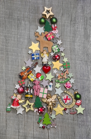 christmas atmosphere: Christmas tree on a wooden background - an idea for a greeting card