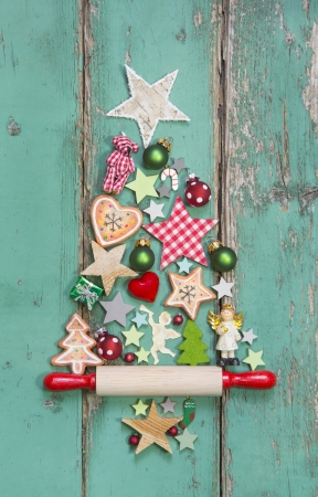 happy christmas: Christmas decoration on a green wooden background as a christmas card