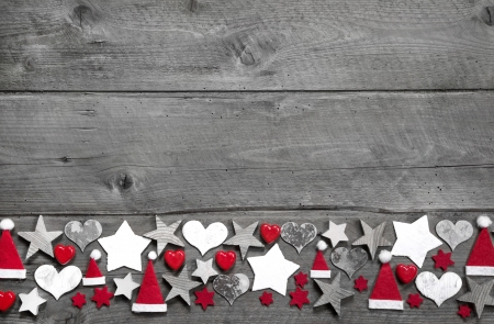 Christmas decoration border on grey wooden background photo