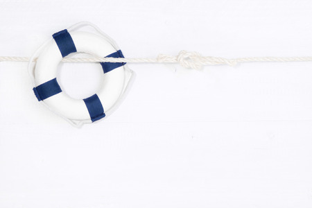 saver: Blue lifebuoy on white background - concept for sailing, cruising, teamwork or holiday