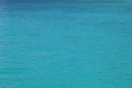 still water: Blue or turquoise ocean surface for a spa or holiday background Stock Photo