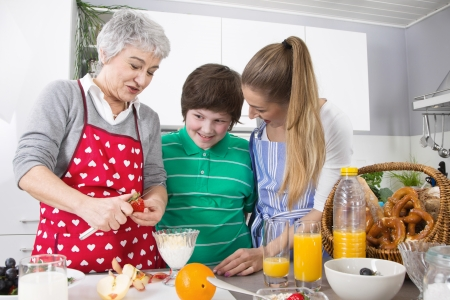 Happy family cooking together - with the grandmother photo