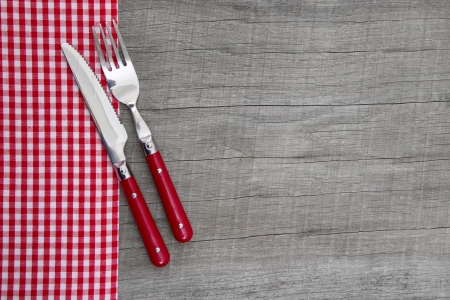 Knife and fork on wooden background for christmas, birthday, valentine photo