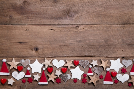 Christmas heart and stars decoration as border or frame on wooden background
