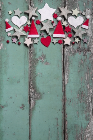 Christmas decoration at top on shabby green wooden background for a frame photo