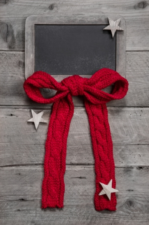 Menu board for christmas with red ribbon and stars on grey wooden background photo