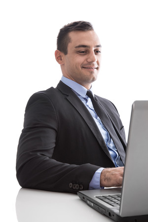 finance director: Young business man looking satisfied with laptop isolated on white background Stock Photo