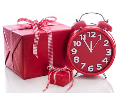 Christmas  big red gift box with red alarm clock - last minute christmas shopping photo