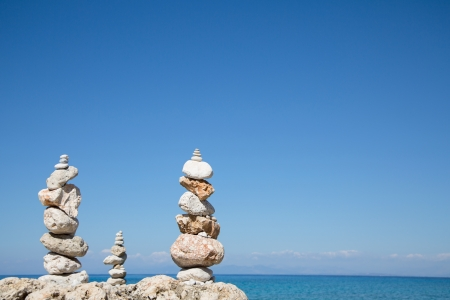 spiritual background: Blue ocean background with a pillar of stones for meditative or spiritual concepts Stock Photo