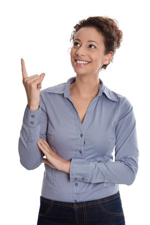 Isolated young pretty business woman is pointing with her index finger  photo