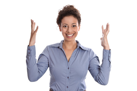 Young business woman looking happy with arms up in air isolated on white  photo