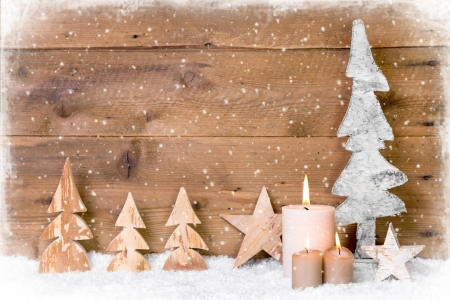 Wooden Christmas trees with candle and snowflake design on wooden - classic for a greeting card