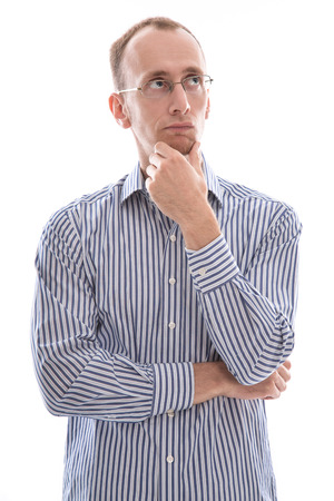 speechless: Man with glasses touching chin and disappointed isolated on white
