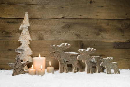 advent: Wooden Christmas tree with elk or reindeer, four candles on wooden for a greeting card