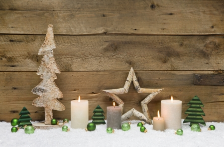 ecard: Wood Christmas decoration with green balls, candles and stars on wooden - greeting card