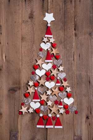 New design for a christmas tree - red and white decoration for xmas on a wooden brown  photo