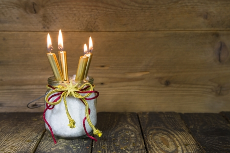 24 month old: Four golden candles -  traditional christmas decoration on a wooden  Stock Photo