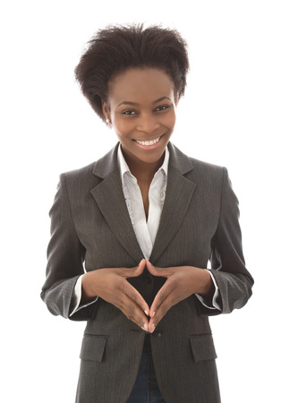 lenguaje corporal: Negocio: mujer negro satisfecho mirando a cámara aislada sobre fondo blanco - sonriendo Foto de archivo